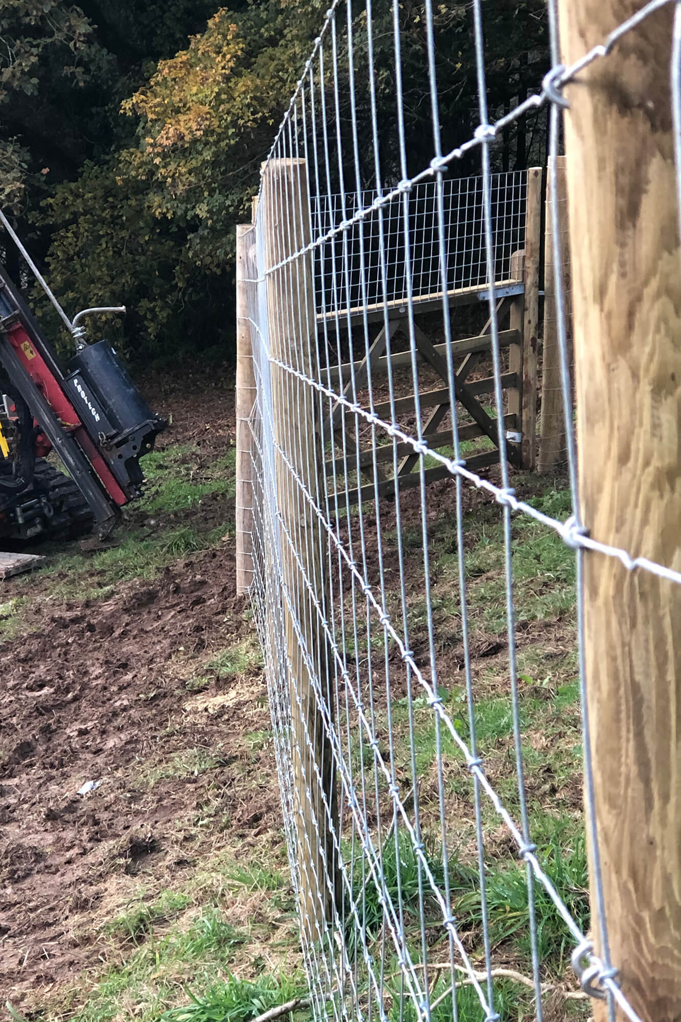 Tracked fencing post driver with hydraulic winch